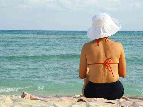 A woman relaxing at the Mediterranean Sea