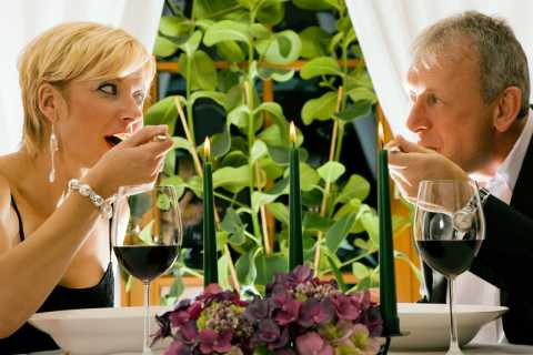 A middle age couple have dinner, part of their healthy meals plans