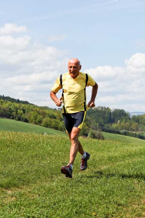 Senior gentleman jogging by the countryside